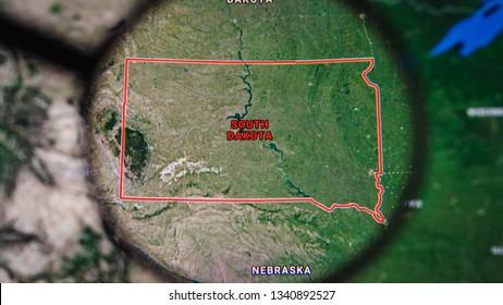 MIAMI BEACH. FLORIDA. USA - MARCH 2019: USA, South Dakota on the political map. The borders of South Dakota. South Dakota State under a magnifying glass. Geography of South Dakota in the USA