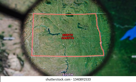 MIAMI BEACH. FLORIDA. USA - MARCH 2019: USA, North Dakota on the political map. The borders of North Dakota. North Dakota State under a magnifying glass. Geography of North Dakota in the USA