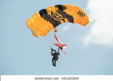 Miami Beach, Florida / USA - March 25 2019: A closeup of a member of the U.S. Army Golden Knights parachute team on his descent at the Hyundai Air and Sea show in Miami Beach.