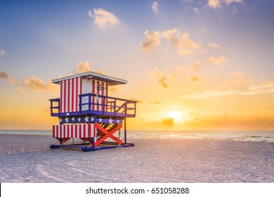 Miami Beach, Florida, USA sunrise and life guard tower.