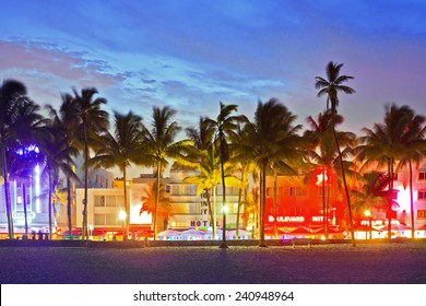 MIAMI BEACH, FLORIDA, USA-JUNE,13: Illuminated hotels and restaurants at sunset on Ocean Drive on June 13, 2013, world famous destination for nightlife, beautiful weather and pristine beaches