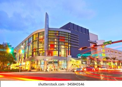 Miami Beach, Florida USA-November 13, 2015: Lincoln Road Mall Movie Theater and moving traffic at sunset, beautiful colorful architecture in the famous tourist destination of Miami Beach