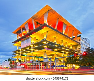 Miami Beach, Florida USA-November 13, 2015:Mixed use building, designed by famous architects Herzog & de Meuron in Lincoln Road, Miami, FL, shops, dining and parking. Sunset shot with moving traffic