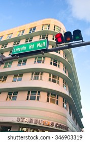 Miami Beach, Florida USA-November 13, 2015: Lincoln Road Mall traffic sign and art deco architecture  on a beautiful morning. Pedestrian area stores, famous brands, restaurants and entertainment