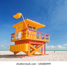 Miami Beach Florida, yellow lifeguard house in typical Art Deco architecture during summer day with blue sky