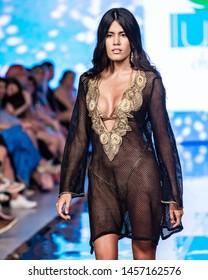 Miami Beach, Florida/USA – July 14 2019: A model walks the runway during the WAIKIKI SWIM show At Miami Swim Week Powered By Art Hearts Fashion Swim/Resort 2019/20 at Faena Forum.