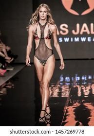 Miami Beach, Florida/USA – July 14 2019: A model walks the runway during the PAS JALOU SWIMWEAR show at Miami Swim Week Powered By Art Hearts Fashion Swim/Resort 2019/20 at Faena Forum.