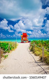 Miami Beach in South Beach with new lifeguard tower and coastline with colorful cloud and blue sky. Florida. USA.