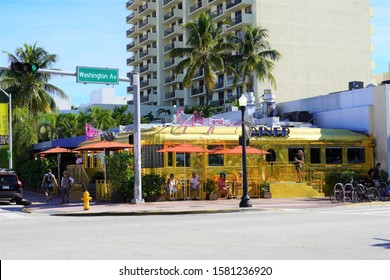 Miami Beach, USA - December 6th, 2019: The 11th Street Diner, a retro chrome diner, is covered in gold as a part of the 2019 Miami Beach Art Basel festival
