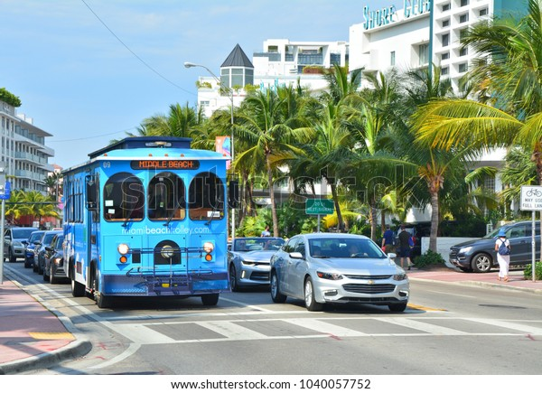 MIAMI BEACH, USA - MARCH 31, 2017 : Blue trolley on the bus stop in Miami Beach. Miami BeachTrolley provides free transportation in the city