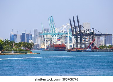 MIAMI BEACH, USA - MAY 9, 2015: The Port of Miami with big containerships and cranes, in the back the skyline.