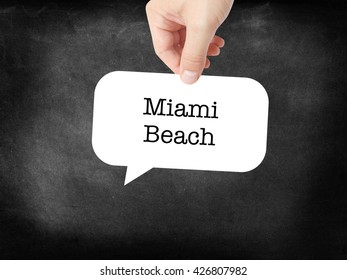 Miami Beach written on a speechbubble