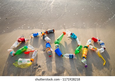 MIAMI - CIRCA JULY, 2018: 'STOP' spelled out in the sand using garbage collected on Miami beach and in the sea as a message for people to take action on plastic pollution