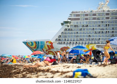 MIAMI - CIRCA JUNE, 2018: Norwegian Getaway cruise ship leaves port and passes South Beach busy with sunbathers.