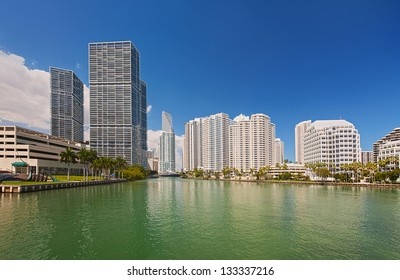 Miami city Florida, USA, view of downtown financial buildings and Brickell key on a summer day with blue sky and green waters of Biscayne Bay