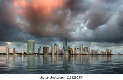 Miami cityscape skyline at sunrise on cloudy morning with an artificial sea illustrating flooding concept