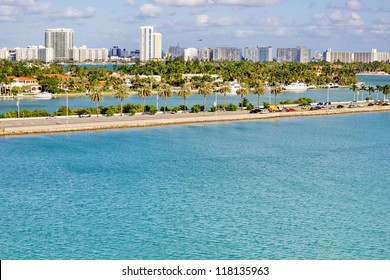 Miami coast from across the water on sunny day.