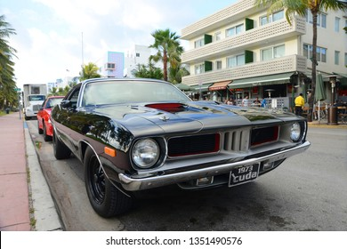 MIAMI - DEC 24, 2012: 1973 Plymouth Barracuda on Ocean Drive in South Beach, Miami Beach, Florida, USA.