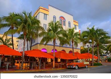 MIAMI - DEC 24, 2012: Edison Hotel with Art Deco Style Building and antique Chevrolet Bel Air in Miami Beach at sunrise in Miami, Florida, USA.