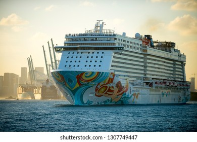 MIAMI - DECEMBER 25, 2018: The Norwegian Getaway cruise ship, which scores a C for air pollution reduction, departs PortMiami at sunset.