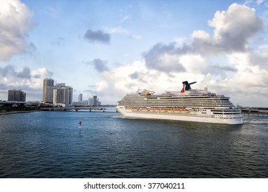 Miami, December 27, 2015: Beautiful marine view with one large Carnival cruise line ship in port going to destination on cloudy blue sky background, horizontal picture