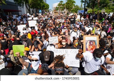 Miami Downtown, FL, USA - MAY 31, 2020: George Floyd protests spread across America. Crowds of white and black people at a demonstration for human rights. Black lives matter