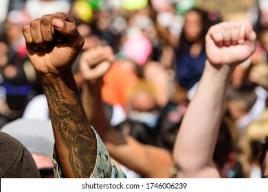 Miami Downtown, FL, USA - MAY 31, 2020: Hands of white and black people during a protest against racism in America