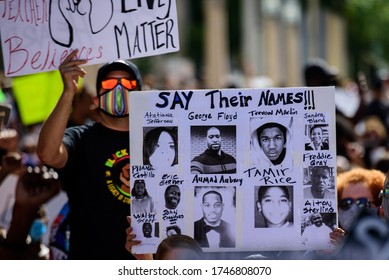 Miami Downtown, FL, USA - MAY 31, 2020: George Floyd, Tamir Rice, Atatiana Jefferson, Trayvon Martin, Ahmed Aubrey, Eric Garner, Sandra Bland, Freddie Gray, Alton Sterling poster. US people protest