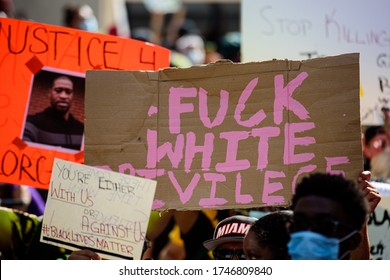 Miami Downtown, FL, USA - MAY 31, 2020: Against white privilege poster. Justice for George Floyd. Peaceful protests after Floyd death