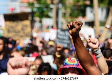 Miami Downtown, FL, USA - MAY 31, 2020: Black hand at a peaceful protest. Human rights. The situation in the USA with demonstrations after Minneapolis killing. George Floyd death