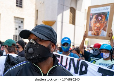 Miami Downtown, FL, USA - MAY 31, 2020: Black people wearing masks on demonstrations. Black Lives Matter. Many american people went to peaceful protests in the US against the George Floyd death