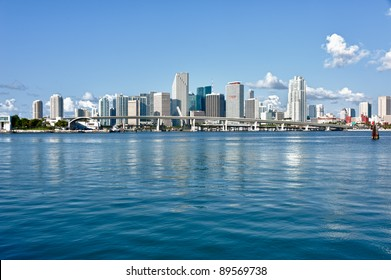 Miami Downtown skyline in daytime with Biscayne Bay. All logos and brand names of building removed.