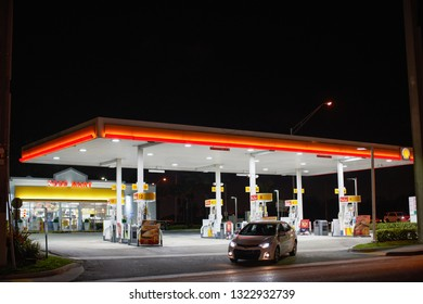 MIAMI - FEBRUARY 24, 2019: Car exiting a gas station at night