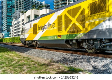 Miami, FL / dade county - 06-15-19: brightline train passing by miami design district, train tracks intersection on NE 2nd ave. and NE 36th st.