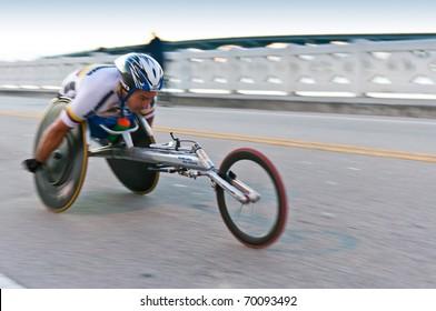 MIAMI, FL - JANUARY 30: Competitor Orlando Cortes, races in a wheekchair during the Miami Marathon. January 30, 2011 in Miami, Florida.