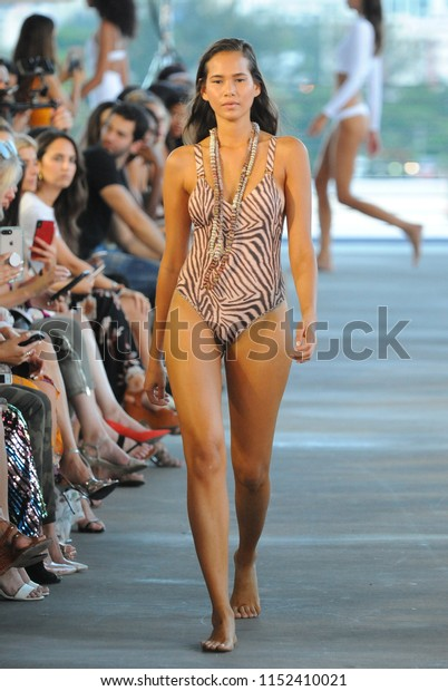 MIAMI, FL - JULY 14: A model walks the runway for Acacia Resort 2019 during Paraiso Fashion Fair at 1111 Lincoln Road on July 14, 2018 in Miami, Florida.