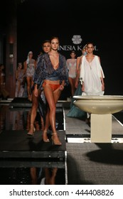 MIAMI, FL - JULY 17: A model walk runway in designers swim apparel for the Sinesia Karol fashion presentation at Setai hotel during Miami Swim Fashion Week on July 17, 2015