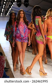 MIAMI, FL - JULY 20: Models walks the runway at the Luli Fama during MBFW Swim 2015 at The Raleigh hotel on July 20, 2014 in Miami, FL.