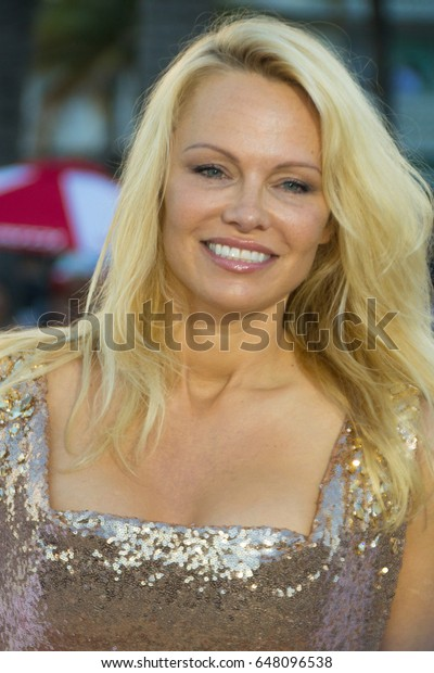 MIAMI, FL - MAY 13, 2017:  Pamela Anderson arrives at the premiere of Baywatch the movie on May 13, 2017, in Miami Florida.