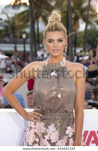 MIAMI, FL - MAY 13, 2017: Kelly Rohrbach arrives at the premiere of Baywatch the movie on May 13, 2017, in Miami Florida.