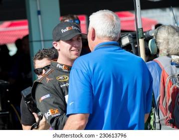 MIAMI, FL - Nov 14: Denny Hamlin (left) talking to Dale Jarrett at the Nascar Sprint Cup Ford Ecoboost 400 practice at Miami Speedway in Homestead, FL on Nov 14, 2014