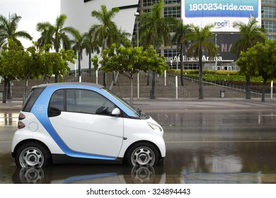 MIAMI, FL - SEPTEMBER 29: Image of a Car2go parked at Downtown Miami on Biscayne Boulevard while flood waters rise from recent storms on September 29, 2015 in Miami, FL