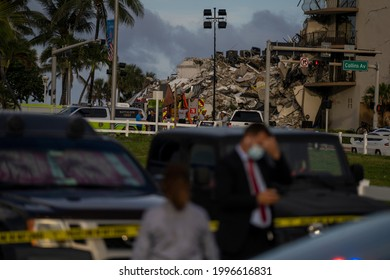 MIAMI, FL, UNITED STATES - JUNE 24, 2021:  People watch a partially collapsed building in Surfside north of Miami Beach.