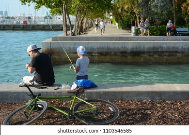 MIAMI, FL, USA -20 JANUARY 2018: Father and son fishing near South Pointe Park Pier in Miami Beach