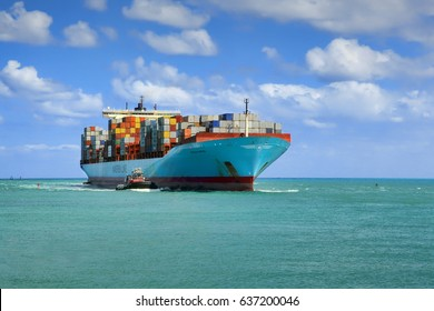 Miami, Fl, USA - APRIL 13, 2017: Large cargo ship Adrian Maersk from Maersk Line with many shipping containers sailing to port Miami