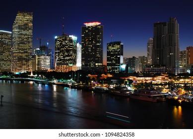 Miami, FL, USA December 1, 2008 Marine traffic cruises the Intercoastal Waterway in front of the Miami, Florida skyline at night