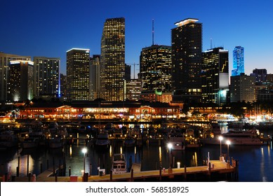 Miami, FL, USA December 1, 2008 The skyline of Miami, as seen from the Bayside Marina, glows against a twilight sky