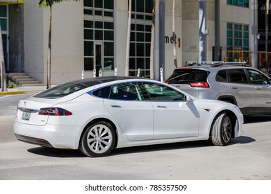 MIAMI, FL, USA - DECEMBER 31, 2017: Image of a white Tesla Model s 60d luxury electric vehicle on the streets of Downtown Miami