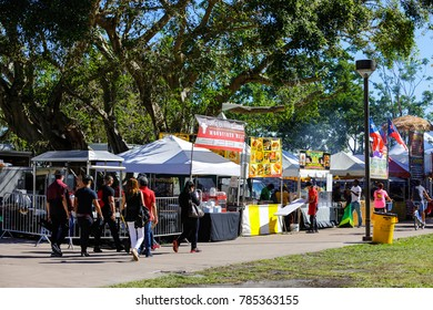 MIAMI, FL, USA - DECEMBER 31, 2017: Image of tourists and food vendors setup for the 2018 new years party celebration