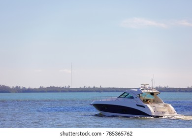 MIAMI, FL, USA - DECEMBER 31, 2017: Image of people aborad a Sea Ray Sundancer recreational yacht in Miami